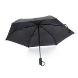 Black umbrella isolated over the white background Stock Images