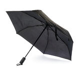 Black umbrella isolated over the white background Royalty Free Stock Images