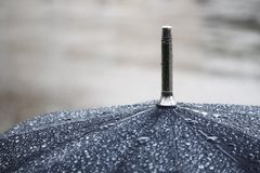 A black umbrella under rain stock photo
