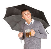Black umbrella and young man with beer Royalty Free Stock Photography