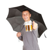 Black umbrella and young man with beer Royalty Free Stock Images