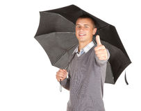 Black umbrella and young man with thumb up. White background Stock Image