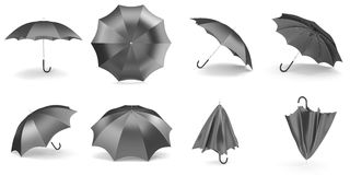Black umbrellas and parasols in various positions open and folded collection. 3d rendering Royalty Free Stock Image