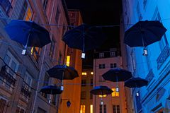 Black umbrellas on the street Royalty Free Stock Images