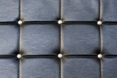 Black upholstery pattern with diamonds Stock Photos