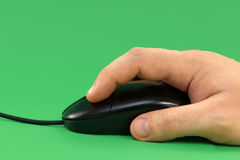 Black USB mouse with cable in hand Royalty Free Stock Image