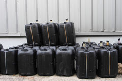 Black used oil gallons pile Royalty Free Stock Photos