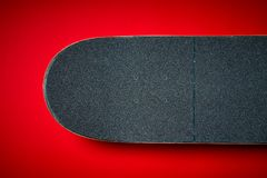 Used skateboard on a red background Stock Image