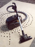 Black vacuum cleaner on carpet Royalty Free Stock Image