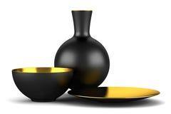 Black vase with bowls isolated on white Stock Photos