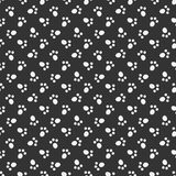 Black vector animal footprint seamless pattern. Cat or dog paw footprint texture Stock Photos