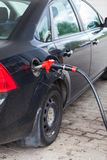Black vehicle refueling with gasoline Royalty Free Stock Photos