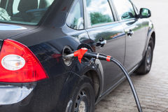 Black vehicle refueling with petrol Stock Photos