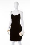 Black velvet dress on white mannequin. Stock Photo