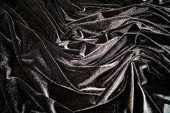 Black velvet material folds Stock Photography