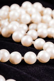 Black velvet and pearls Royalty Free Stock Photo