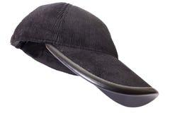 Black velveteen sports cap. On a white background Stock Photography