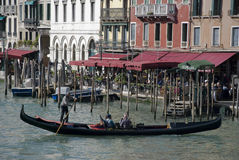 Black venetian gondola on canal grande Royalty Free Stock Images