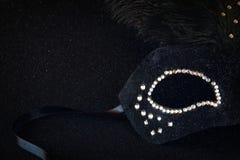 black venetian mask on glitter background Stock Photo
