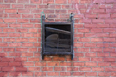 Black Vent on Red Brick Wall Royalty Free Stock Photos