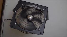 Black ventilation fan on the wall. Fast turns stock video footage