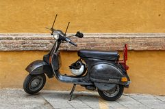 Black Vespa motorbike in Siena, Italy. stock photos