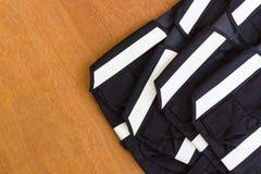 Black vest and white stripes overlay. Stock Photo