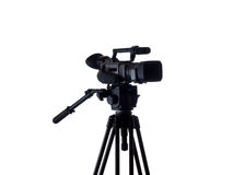 Black video camera mounted on tripod 3/4 view Royalty Free Stock Photos