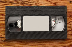 Black video cassette. On the wooden background stock photos