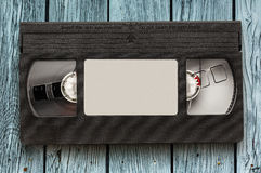 Black video cassette. On the wooden background stock photo