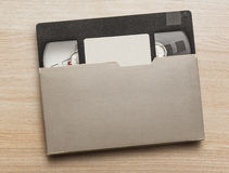 Black video cassette. On the wooden background royalty free stock photo
