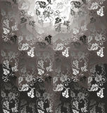 Black vine. Background of the vine with black and white leaves on a brown Stock Images