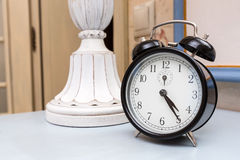 Black vintage alarm clock Royalty Free Stock Image