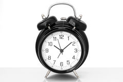 Black vintage alarm clock with white background Stock Images