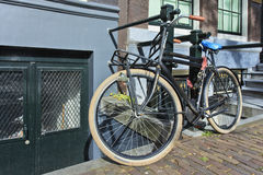 Black vintage bicycle in Amsterdam. Royalty Free Stock Images