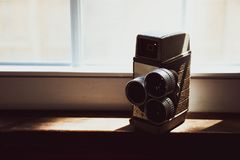 Black Vintage Camera On Table stock image