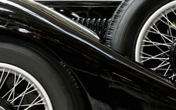 Black vintage car. Fender and tires of an black vintage car Stock Photos