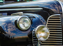 Black vintage car. Close-up fragment of a black vintage car. Retro car. Headlights of vintage car. Selective focus Royalty Free Stock Photography