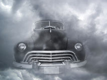 Black Vintage Car in Fog. Vintage American car emerging from fog. Full frontal view Royalty Free Stock Photos