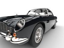 Black vintage car - headlight and tire closeup Royalty Free Stock Image