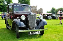Black vintage car. NOTTINGHAM, UK - JUNE 1, 2014: Frontal view of a rare black Austin retro car for sale in Nottingham, England Royalty Free Stock Photography