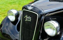 Black vintage car. NOTTINGHAM, UK - JUNE 1, 2014: Frontal view of a rare black Austin retro car for sale in Nottingham, England Stock Photo