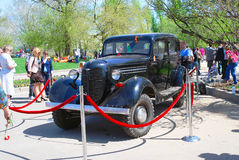 A black vintage car put in the park behind red ribbon Stock Photos