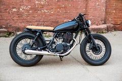 Black vintage custom motorcycle cafe racer Royalty Free Stock Image