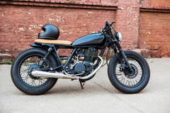 Black vintage custom motorcycle cafe racer Royalty Free Stock Photo