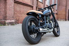 Black vintage custom motorcycle caferacer Royalty Free Stock Image
