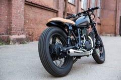 Black vintage custom motorcycle caferacer Royalty Free Stock Image