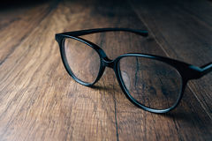 Black Vintage Eye Glasses. On wooden background Royalty Free Stock Photography