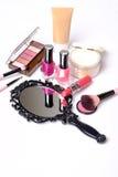 Black vintage hand mirror on white background. Black vintage hand mirror with cosmetics makeup on white background Royalty Free Stock Image