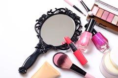 Black vintage hand mirror on white background. Black vintage hand mirror with cosmetics makeup on white background Stock Images